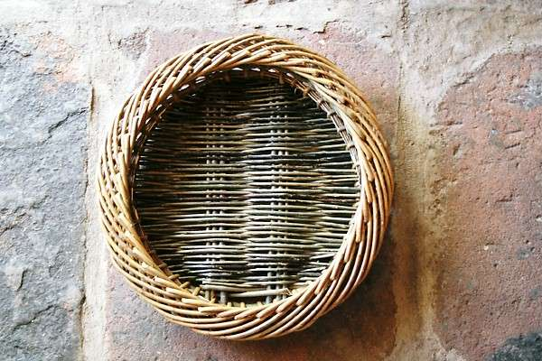 Shallow woven bowl